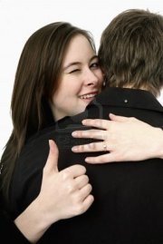8260351-man-and-woman-hugging-woman-showing-thumbs-up